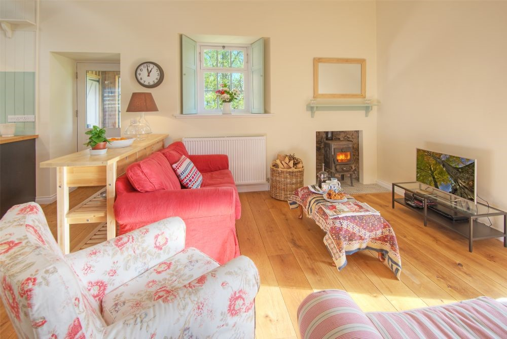 Laundry Cottage - sitting room with wood burning stove