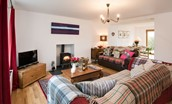 Leitholm Cottage - seating area & wood burning stove