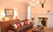 Middleton Hall Coach House - sitting room with wood burning stove