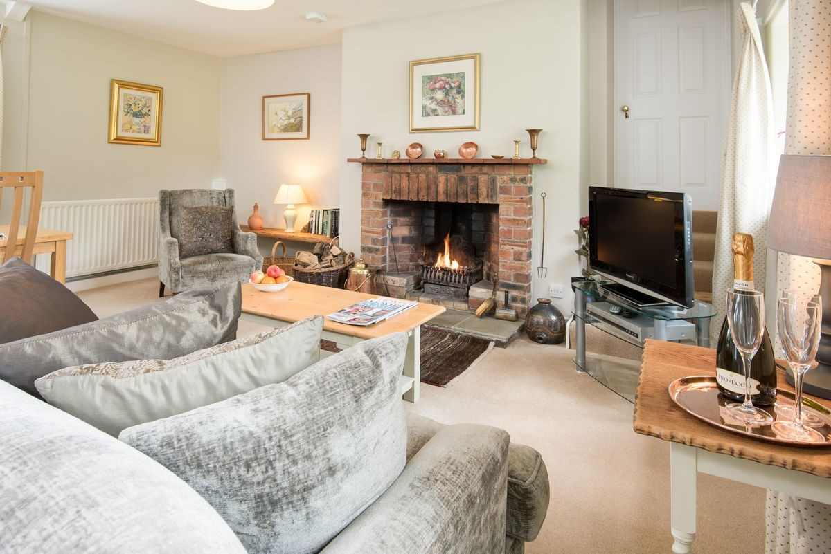 Milfield Hill Cottage - sitting room with open fire