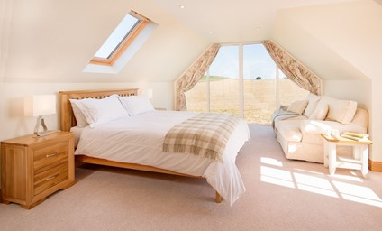 Waking up in the large sunny master bedroom to fantastic panoramic views across rolling Border farmland to the Cheviot Hills beyond.
