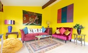 Lowtown Cottage - sun room filled with colour and artworks