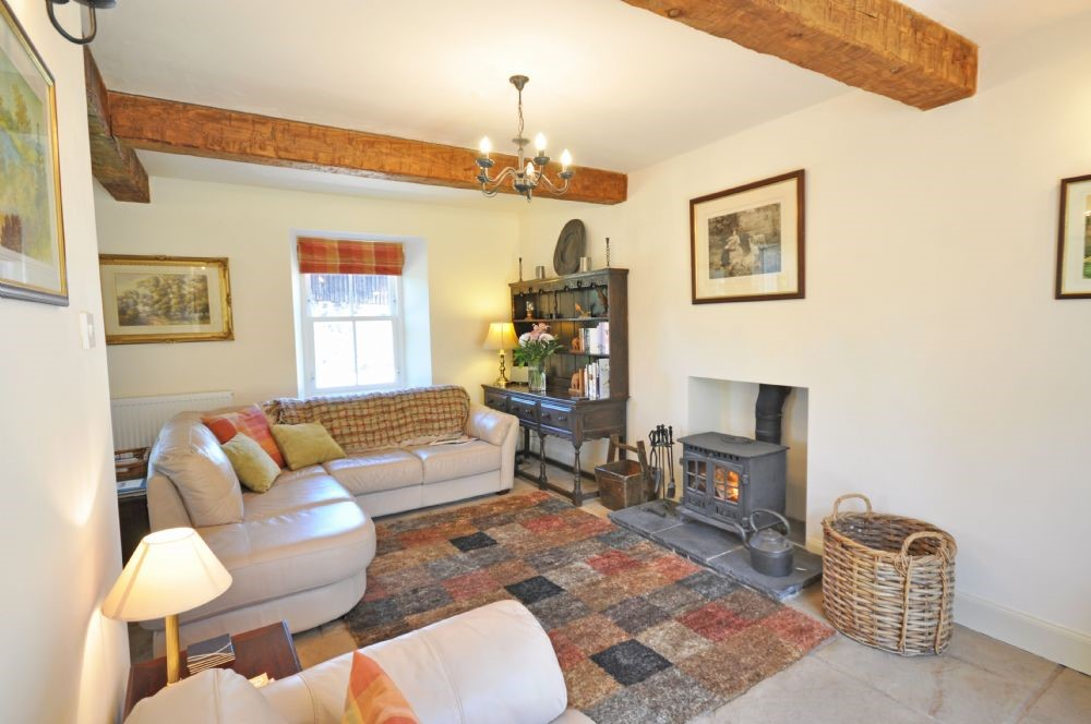 Old Mill Cottage - sitting room with wood burning stove