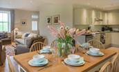Pathhead Farmhouse - dining table in open plan living area