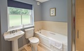 Pathhead Farmhouse - bedroom one en suite bathroom