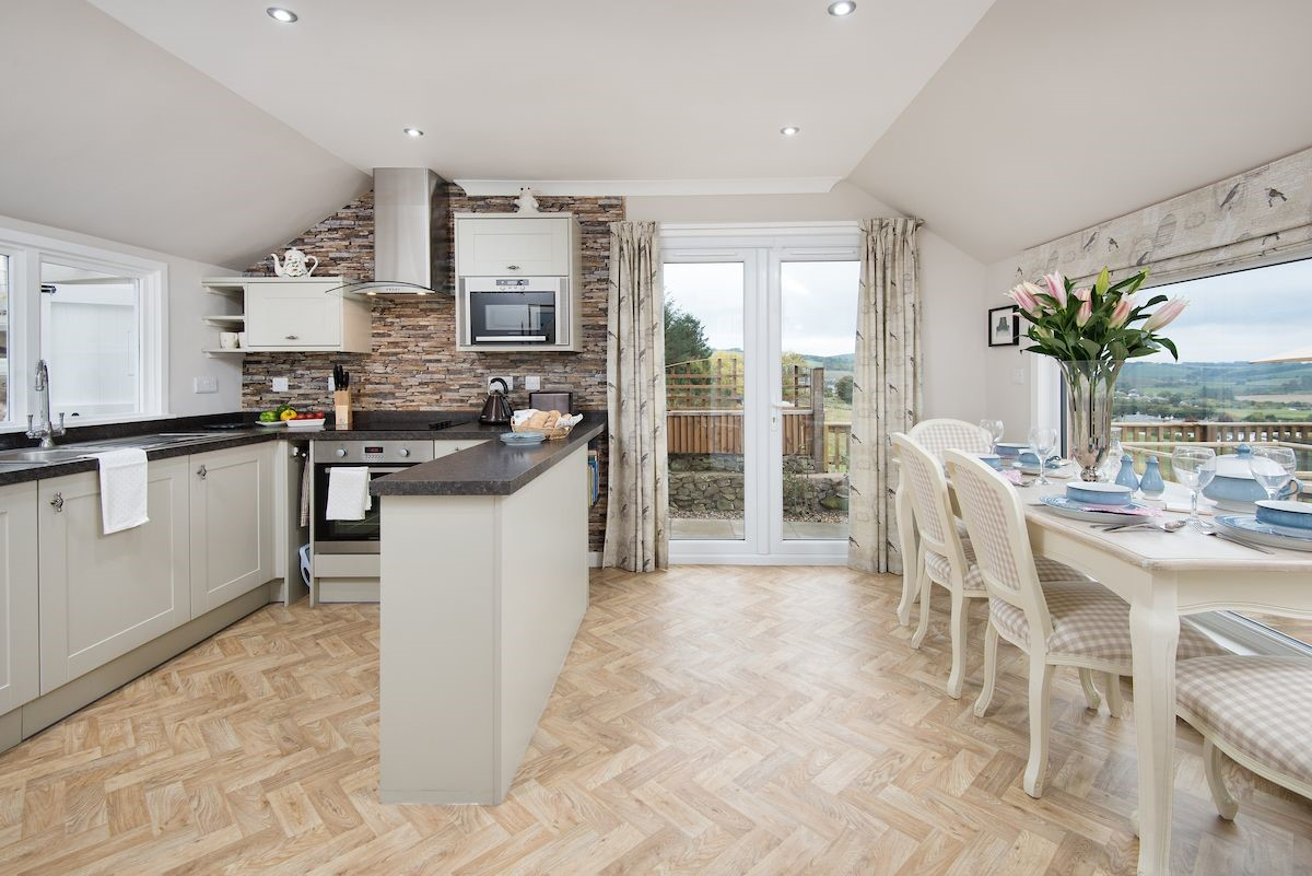 Pennine Way Cottage - kitchen & dining area with doors to terrace