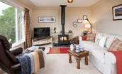 Pennine Way Cottage - sitting room with wood burning stove
