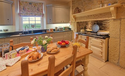 Cooking together in the spacious country-style kitchen using fresh produce collected from the impressive vegetable garden.