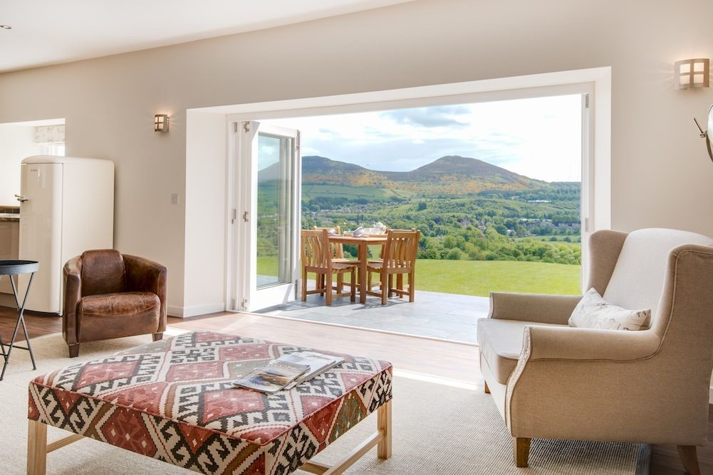 Fold back the bi-folding doors and admire the incredible views of the Eildons and surrounding countryside.