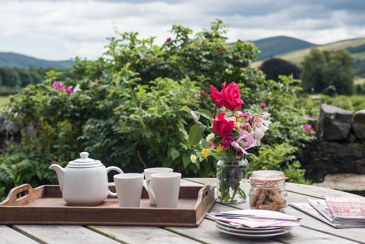Enjoy dining al fresco in the sweet patio garden while admiring the incredible views of the Cheviots.