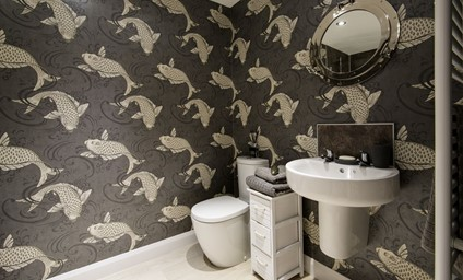 The statement wallpaper in the bathroom was chosen by the owners. It adds such charm to the room.