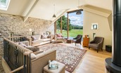 The Barn & The Cowshed - sitting room with wood burning stove