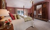 The Boathouse - bedroom two with four poster bed
