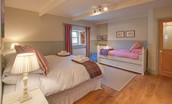 The Bothy at Reedsford - bedroom two with zip and link bed & single bed