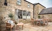 Old Granary House - large patio accessed through bi-folding doors with outdoor dining area to seat eight