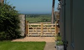 Overview Cottage - entrance gate and view towards Lindisfarne and the coast