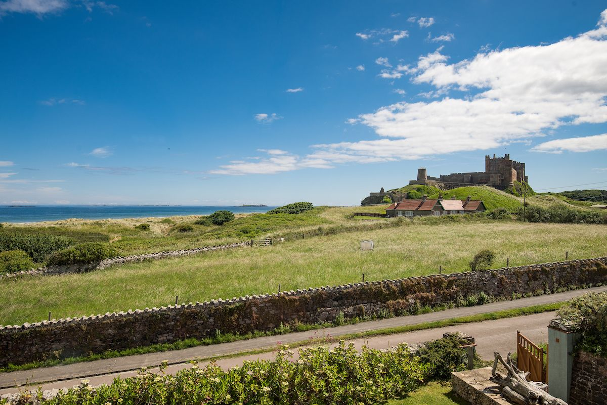 View of Bamburgh Castle and the sea from The Shieling holiday cottage, from Bamburgh on the Northumberland coast