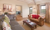 The Smithy, Crookham - sitting room with kitchen access