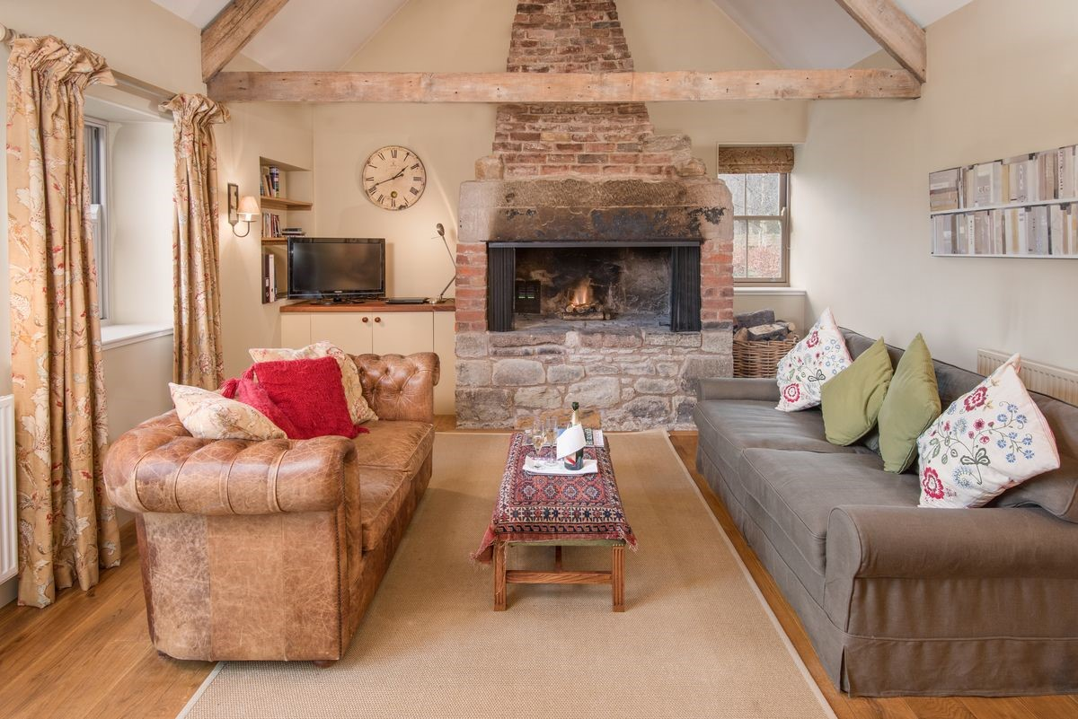 The Smithy, Crookham - sitting room with fire