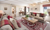 Tweedswood - sitting room with access to kitchen
