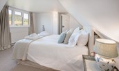 Tweedswood - bedroom one with double bed