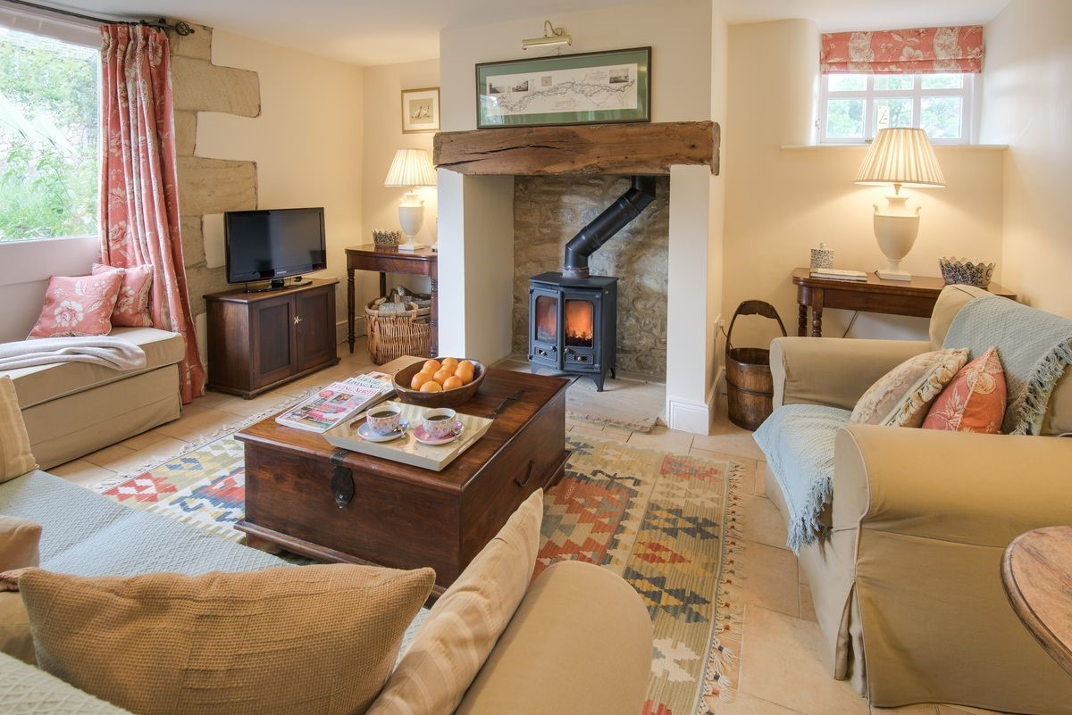 West Cottage - sitting room with wood burning stove