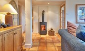 Whitehall West Lodge - open plan living area with wood burning stove
