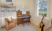 Whitehall West Lodge - playroom with musical instruments
