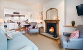 Swan's Nest - open plan living area with the beauty of an open fire