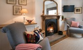 Swan's Nest - enjoy some relaxation time with a good book in front of the fireside