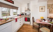 Swan's Nest - bright kitchen area with views over the garden