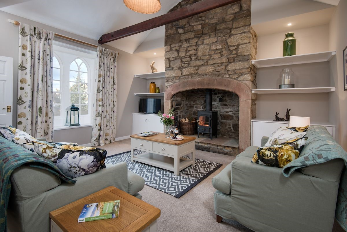 Curlew Cottage - sitting room with wood burning stove
