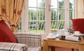 Dryburgh Farmhouse One - bedroom one with Juliet balcony & seating area