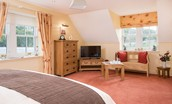 Dryburgh Farmhouse One - bedroom two with seating area