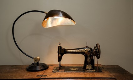The original Singer sewing machine gives a lovely nod to the apartment's past life.