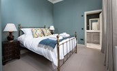 The Maitland Apartment - bedroom one with en suite bathroom access