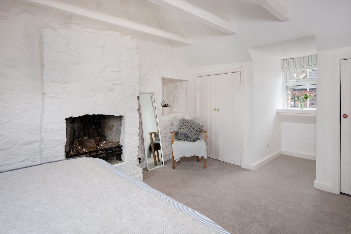 Apple Cottage - bedroom one with fireplace