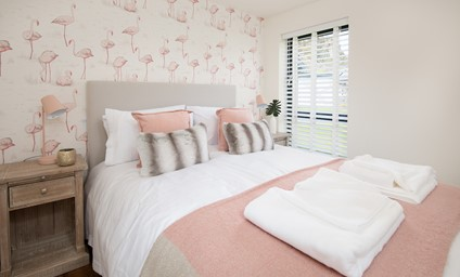 Each of the three bedrooms have been decorated in a unique wallpaper. Bedroom two flaunts a fabulous flamingo design - a perfectly pink and calming sanctuary.