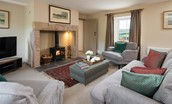 Dipper Cottage - sitting room with woodburner