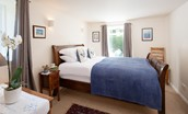 Polwarth Rhodes Cottage - bedroom one with king size bed - ground floor