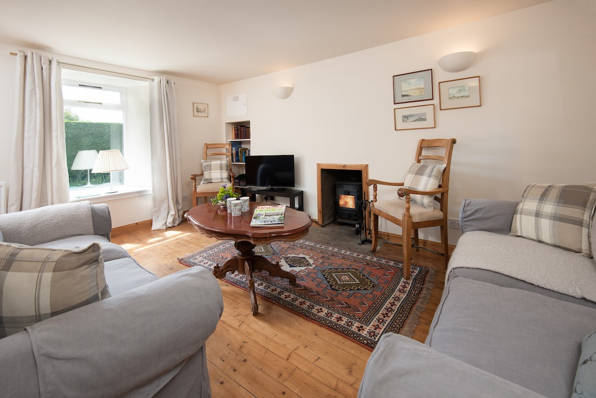 Polwarth Rhodes Cottage - sitting room with wood burning stove
