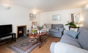 Polwarth Rhodes Cottage - sitting room with two double sofas