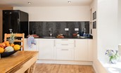 Polwarth Rhodes Cottage - kitchen with large fridge freezer