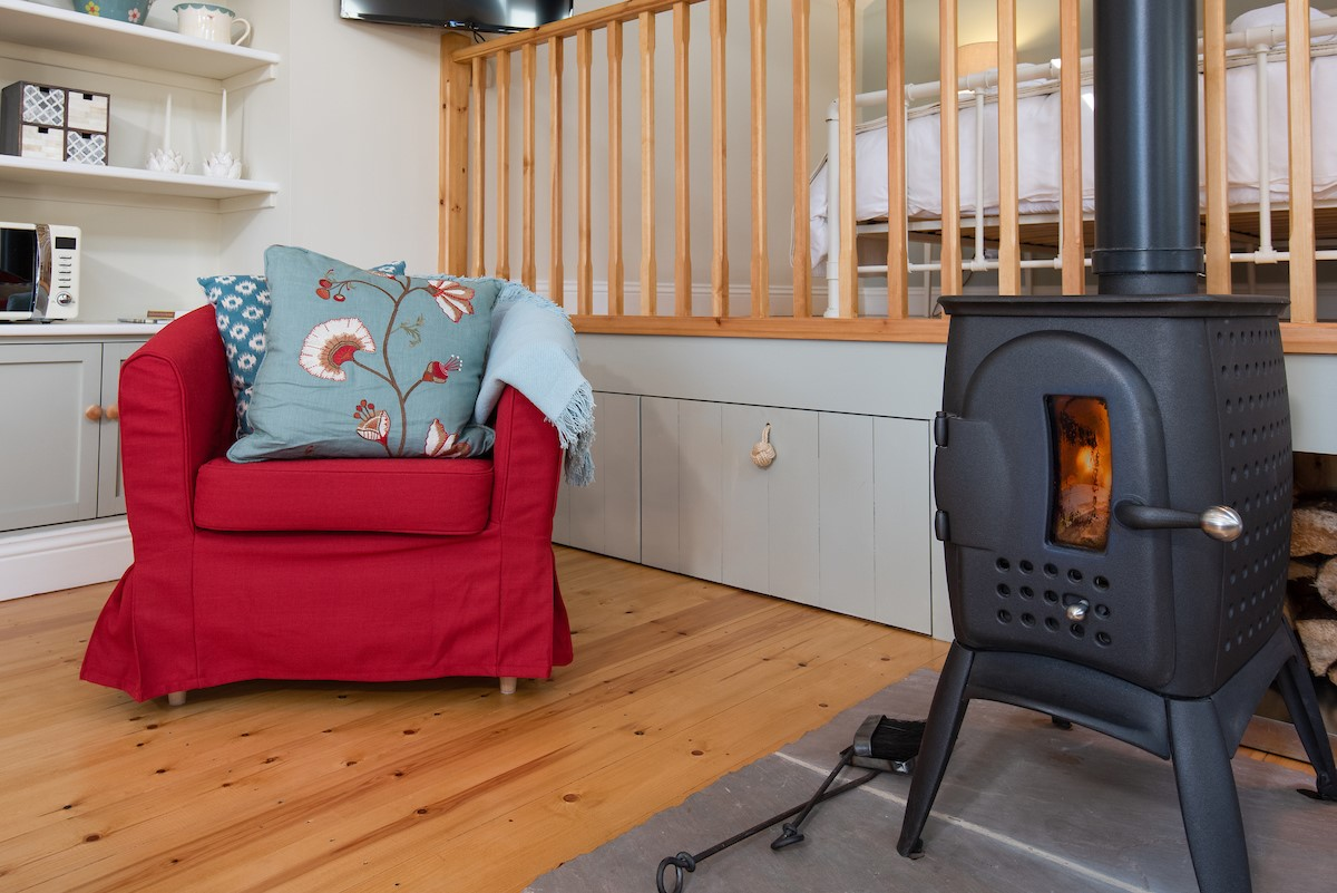 The overall look is quintessentially country, yet with a fresh modern look and a super-impressive wood burner!