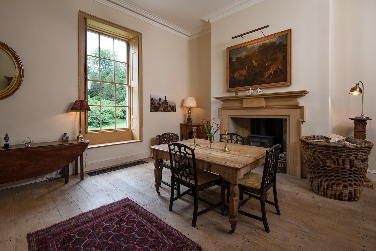 Lorbottle Hall - day room with wood burning stove