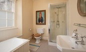 Lorbottle Hall - bedroom 1 en-suite bathroom with bath and separate shower