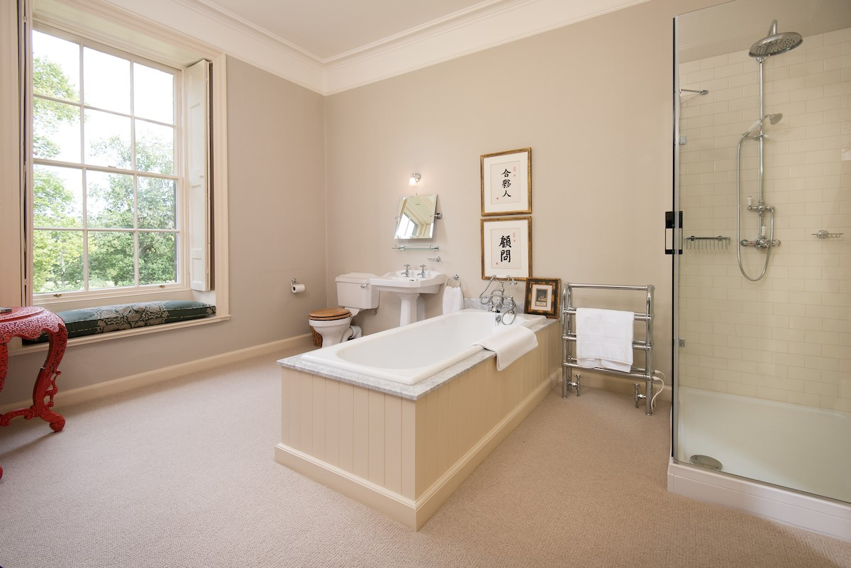 Lorbottle Hall - bedroom 4 en-suite bathroom with bath and separate shower