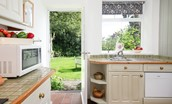 Milfield Hill Cottage - kitchen with rear door to the garden