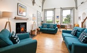The Five Turrets - sitting room area with large wood burner