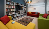 The Five Turrets - mezzanine with library and Smart TV